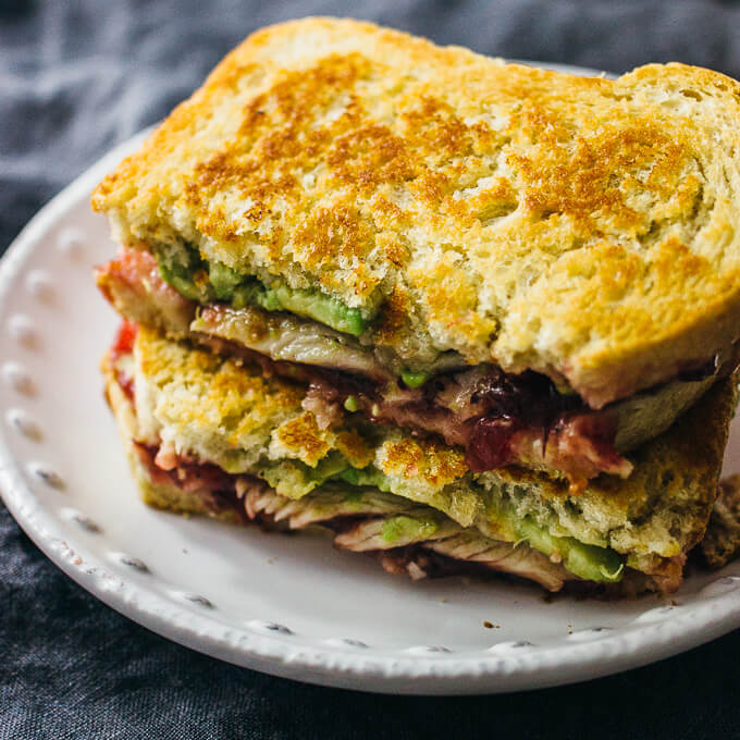 Adding avocado to this sandwich adds an extra, amazing and healthy, layer to your turkey and cranberry sauce leftovers