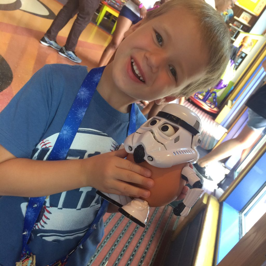 Kids enjoy building and customizing their own Mr. Potato Heads at the Once Upon a Toy store at Disney Springs