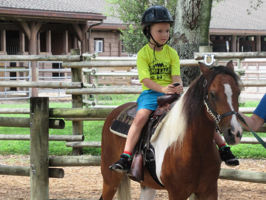 Kids will love spending the day at Ft. Wilderness resort where they can swim, fish, or even take a pony ride.